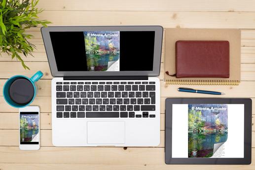 Riviste on line sul laptop con un effetto di capovolgimento di pagina